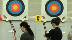 Two young women and archery - stock footage
