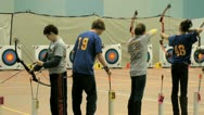 Stock Video Footage of Four young people and archery