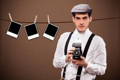 Antique photographer outfit and dslr in front of a polaroid background Stock Photos