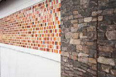 Pattern of mosaic and granite on a decorate wall Stock Photos