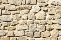 texture of a wall of crushed stone and masonry - stock photo
