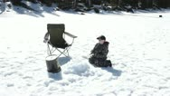 Young boy ice fishing frozen lake winter HD 0894 Stock Footage