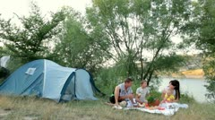 Family summer camping vacation - stock footage