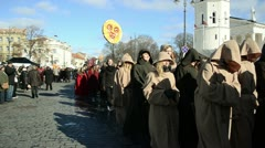 March goes the city street dressed monks and carries statue sun Stock Footage