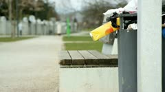 Trash around bin already full Stock Footage