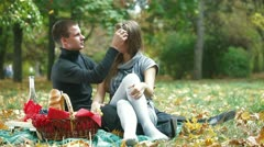 Couple enjoying a warm autumn day on a picnic Stock Footage