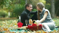 Young loving couple having a picnic - stock footage