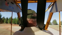 Pilot driving on land in plane - stock footage