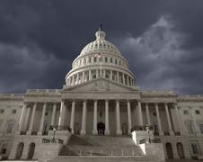 dark sky over the united states capitol in washington dc - stock photo