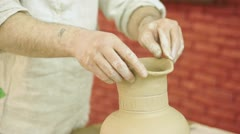 Stock Video Footage of Potter works. Crockery creation process in pottery on potters' wheel