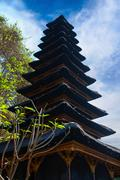 traditional balinese many tier palm roof in the temple - stock photo