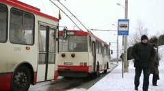 Public transport trolley flags national holiday stop people snow Stock Footage