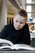 young boy reading - stock photo