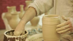 Potter works. Crockery creation process in pottery on potters' wheel - stock footage