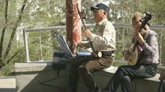 Chinese Musicians In Spring Park - stock footage