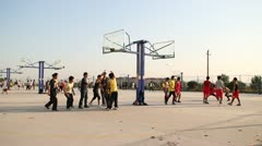 pan China many Chinese university students playing basketball outside - stock footage