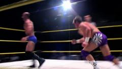 Sports: Pro Wrestling Match - Clothesline to Floor - stock footage