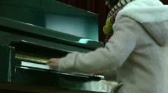 Asian girl in practice piano Stock Footage