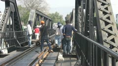Workers on the Bridge Over the River Kwai p88 Stock Footage