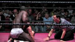 Sports: Pro Wrestling Match - Chinlock / Headlock Submission Hold - stock footage