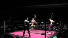 Sports: Pro Wrestling Match - Clothesline to Outside - Static - stock footage