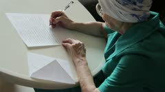 Old woman writing letter Stock Footage