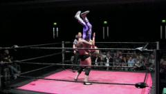 Sports: Pro Wrestling Match - Botched Moonsault Backflip & Powerbomb Finish Stock Footage
