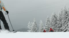 Winter holiday activities, skier skiing, cable cabin passing over  Stock Footage