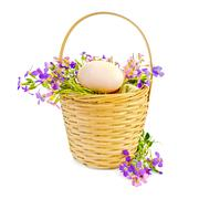 eggs with flowers in a wicker basket - stock photo