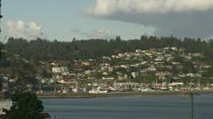 Newport Oregon Harbor Boats and Hillside Neighborhood - med wide Stock Footage
