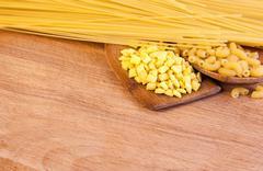 Pasta on a wooden board Stock Photos