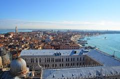 st. mark's cathedral in venice from above with city roofs in distance - stock photo