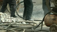 Workers to use an electric drill in the construction site Stock Footage