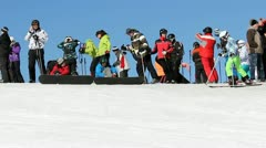 People with ski and skateboards preparing for their winter sports Stock Footage