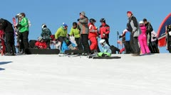 Tourists ready to slide on snowed slope Stock Footage