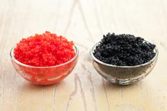 red and black caviar in bowl - stock photo