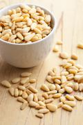 pine nuts in bowl - stock photo