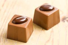 Two chocolate pralines Stock Photos