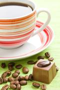 chocolate praline and coffee cup - stock photo
