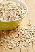 Oatmeal on wooden table Stock Photos