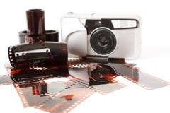 Analog photo camera and color negative films Stock Photos