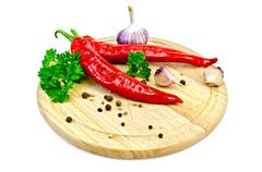 Spice with hot pepper on the board Stock Photos