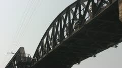 Tourists Crossing the River Kwai Bridge p81 Stock Footage