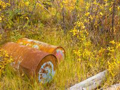 Rusting oil barrels being an environmental hazard Stock Photos
