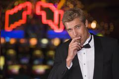 Man in casino with cigar (selective focus) Stock Photos