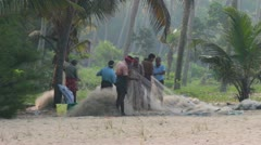 Fishermans preparing fishnets for fishing - India Stock Footage