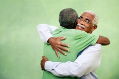 old friends, two senior african american men meeting and hugging - stock photo