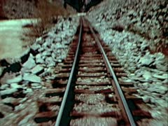 MOUNTAIN PASS FROM REAR OF TRAIN - COLOR - stock footage