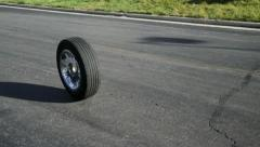 Lone Tire Rolls Down Street Stock Footage