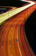 cars at night with motion blur - stock photo